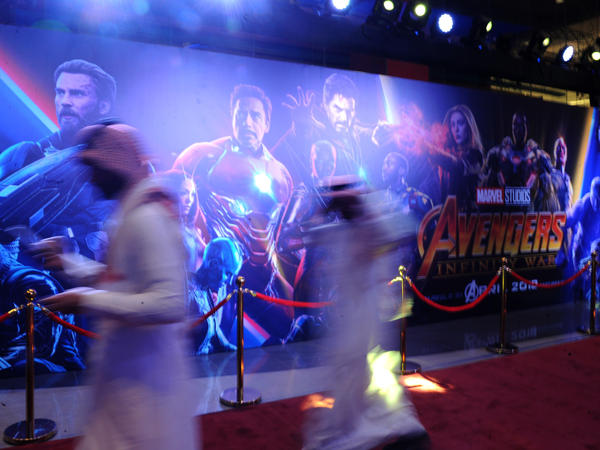 Saudis walk at a cinema in Riyadh after its opening for the general public on April 30.