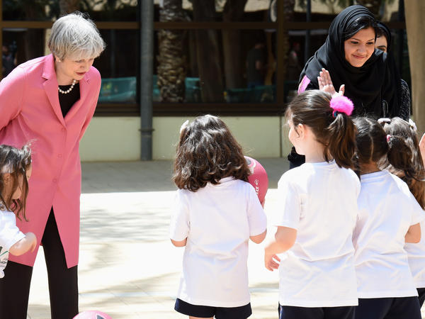 "Princess Reema Bint Bandar al-Saud (right), the head of Saudi Arabia's General Sports Authority, and British Prime Minister Theresa May visit with Saudi girls during a basketball class at the Olympic headquarters in Riyadh on April 5, 2017. ""When you live in a community where, overnight, what was a 'no' is a 'yes,' it's very hard to rationalize if there's no 'why,'"" Bandar says."