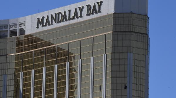 Damaged windows on the 32nd floor room at the Mandalay Bay Resort and Casino used by gunman Stephen Paddock are seen on Oct. 2, 2017. Las Vegas police have released some footage from officers' body cameras.