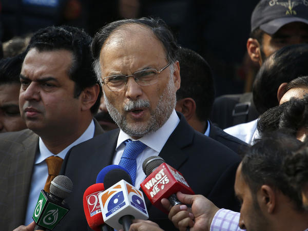 Pakistani Interior Minister Ahsan Iqbal talks to journalists outside the accountability court, in Islamabad, Pakistan, in October.