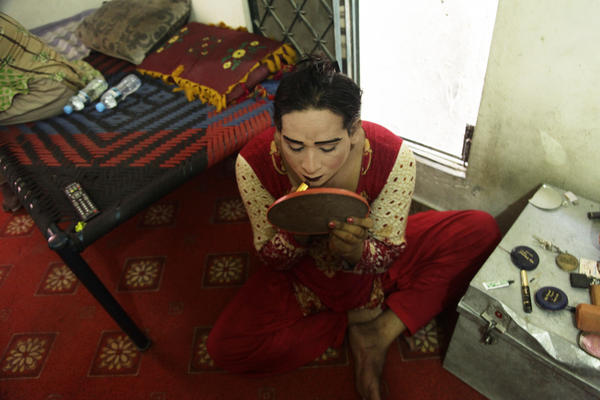A transgender woman named Shabnam applies makeup before stepping out onto Lahore's streets to beg for money. On Tuesday, Pakistani lawmakers passed legislation that gives transgender people fundamental rights.