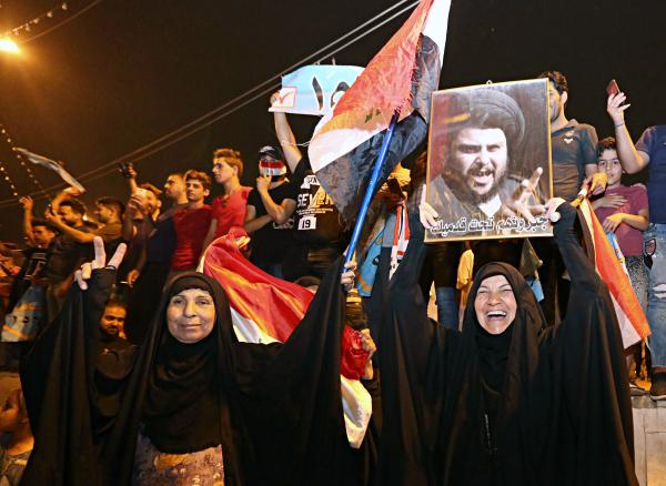 With official results in from just over half of the country's provinces, supporters of the influential Shiite cleric Muqtada al-Sadr celebrate in Tahrir Square, Baghdad, early Monday.