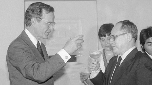 Former Vice President George H.W. Bush met with El Salvador's President Álvaro Magaña in 1983. During the toast, Bush relayed President Ronald Reagan's concern over killings by right-wing death squads. Stephanie Van Reigersberg (center) was Bush's interpreter.