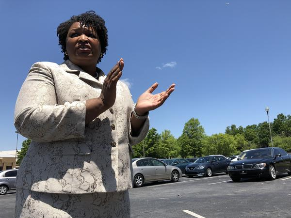 Stacey Abrams gives her supporters a pep talk at an early vote rally in DeKalb County, Ga.