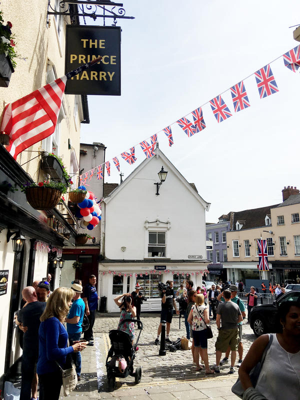 People gather outside the Prince Harry pub in Windsor, England.