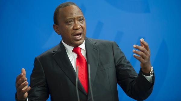 Kenyan President Uhuru Kenyatta, pictured here in Berlin in April, has signed into law a bill that criminalizes cyberbullying and the spread of misinformation.