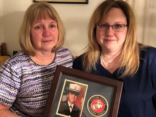 Deana Martorella Orellana's mother, Laurel Martorella, left, and sister, Robin Jewell, with a photo of Deana in uniform.