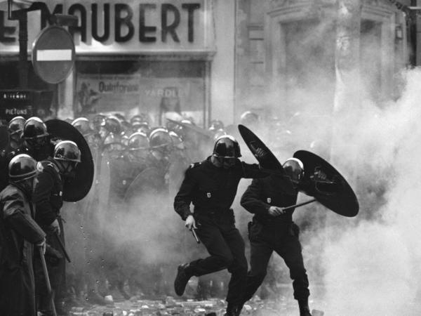 Anti-riot police charge through the streets of Paris during violent student demonstrations on May 6, 1968.