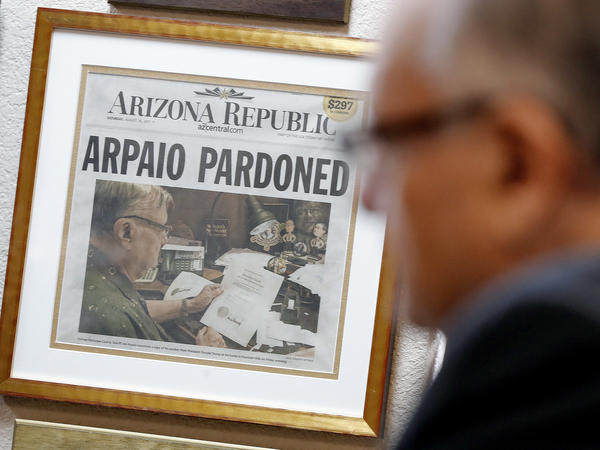 A newspaper declaring the pardon of former Maricopa County Sheriff Joe Arpaio hangs on the wall of his office on Jan. 10, 2018, in Fountain Hills, Ariz. Arpaio was spared a possible jail sentence when President Donald Trump pardoned him.