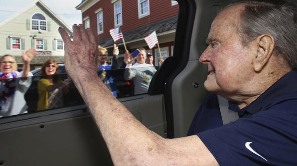 In this May 20 photo provided by the office of George H.W. Bush, the former president waves to supporters as his motorcade arrives in Kennebunkport, Maine. A Bush spokesman said the nation's 41st president was eager to get to Maine after enduring his wife's death and then being hospitalized shortly after that with a blood infection.