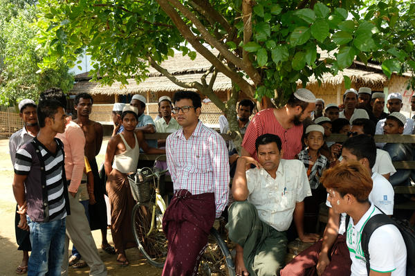 Rohingya residents of Myanmar's Thet Kae Pyin internment camp gather outside a school where camp leaders meet with a visiting U.S. government delegation.