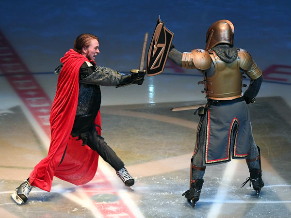 All right, one more shot of the show Monday night: Zack Frongillo, in the red cape, stands in for the Capitals as he makes a hapless attempt to defeat the Golden Knight, played by Lee Orchard. Spoiler alert: The knight wins.