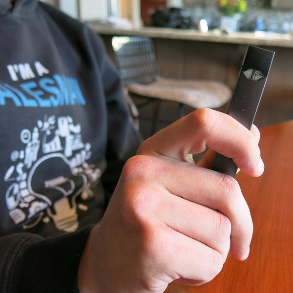 Julien Lavandier holds his Juul up for inspection. The tiny handheld device, typically around the size of a USB flashdrive, simulates the experience of tobacco smoking.