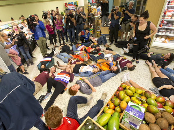 Demonstrators at a die-in at at a Publix Supermarket in Coral Springs, Fla., led by student activist David Hogg. The supermarket chain had backed a gubernatorial candidate allied with the NRA.