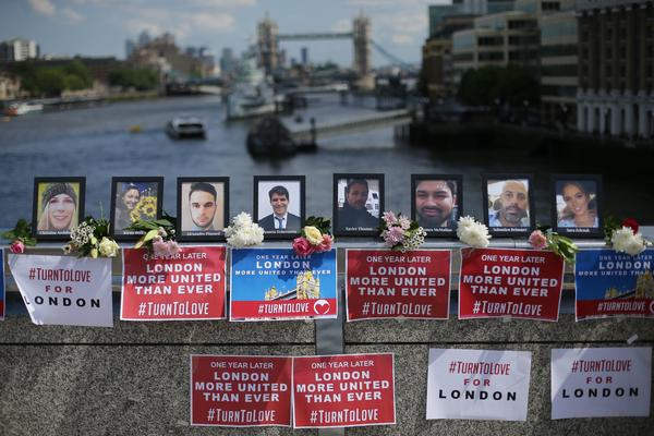 Photographs of the people killed in the London Bridge terror attack are pictured on London Bridge prior to a commemoration service on the first anniversary of the attack.