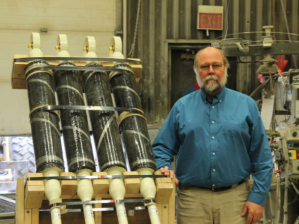 Ed Yarmak of Arctic Foundations with his thermosyphons.  The giant tubes filled with refrigerant suck up warm air and help keep permafrost frozen.