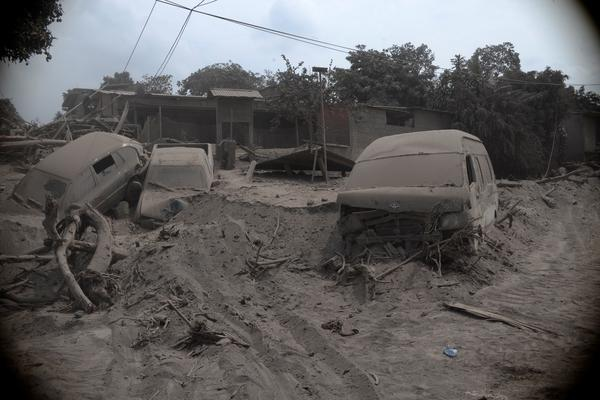 Cars are covered in volcanic ash in San Miguel Los Lotes village in Guatemala City on Tuesday.