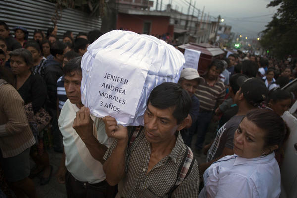 Mourners carry the coffin of 3-year-old Jenifer Andrea Morales, who died during the eruption, as villagers carry seven bodies to the cemetery in San Juan Alotenango, Guatemala, on Monday.