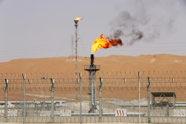 Flames are seen at the production facility of Saudi Aramco's Shaybah oilfield in May.