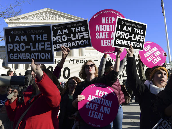 Protesters on both sides of the abortion issue gather outside the Supreme Court in Washington on Jan. 19 during the March for Life.