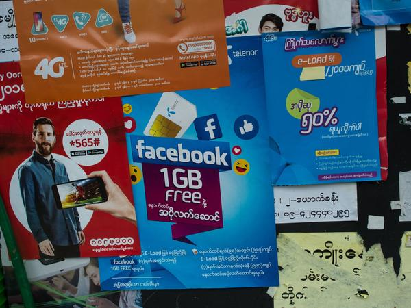 "The Facebook logo is seen on an advertisement by a local telecom company in Yangon. ""People think that Facebook is the Internet. It comes pre-installed on the phones that they buy,"" says a Yangon-based digital activist. There are an estimated 27 million Facebook accounts in Myanmar."