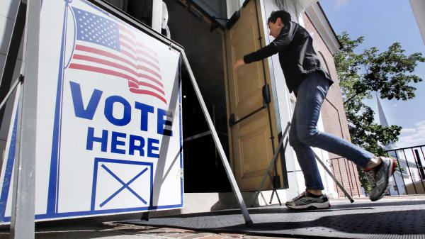 A resident walks in to cast her vote at a polling station in Maine on June 12, in the state's primary elections. Maine is one of 17 states that has yet to apply for election security money allocated this year by congress.