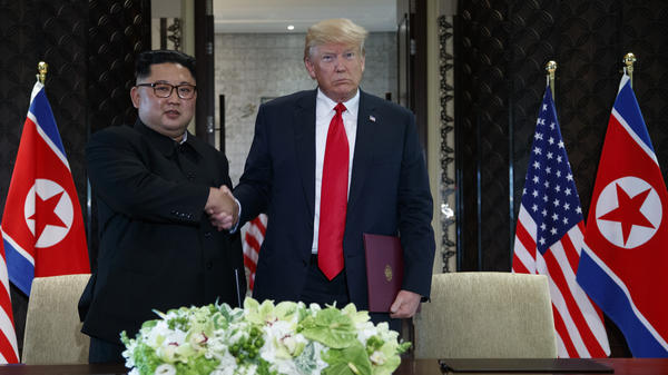 President Trump and North Korean leader Kim Jong Un shake hands during their signing ceremony in Singapore on Tuesday.