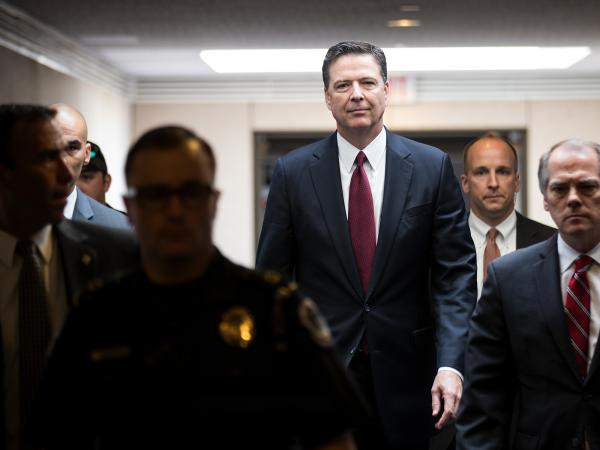 Former FBI Director James Comey leaves a closed session with the Senate intelligence committee on Capitol Hill June 8, 2017, in Washington, D.C.