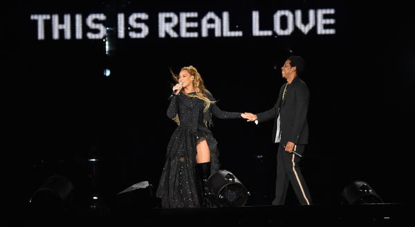 Beyoncé and Jay-Z on stage in Glasgow during their On The Run II tour on June 9, one week before they released the collaborative album <em>Everything Is Love</em>.