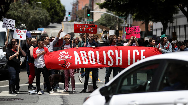 Protesters block a street outside the ICE office in San Francisco on Tuesday.