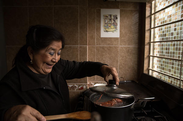 At home, Albino Quiroz's presence can still be felt in the kitchen, the favorite room of his wife, Maricela Peñaloza Flores — and a gift from her husband.