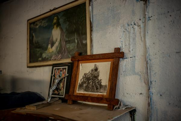 A photo of Mexican revolutionary leader Emiliano Zapata is displayed in one of the bedrooms in Sagrada Familia, one of more than 100 nonprofit migrant shelters like it across Mexico.