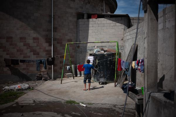 "A Central American migrant hangs his clothes at the refugee center Sagrada Familia. As migrants and asylum-seekers decide whether to risk the effects of the Trump administration's ""zero tolerance"" policy, Mexico's role as a possible destination country for Central Americans becomes more important."