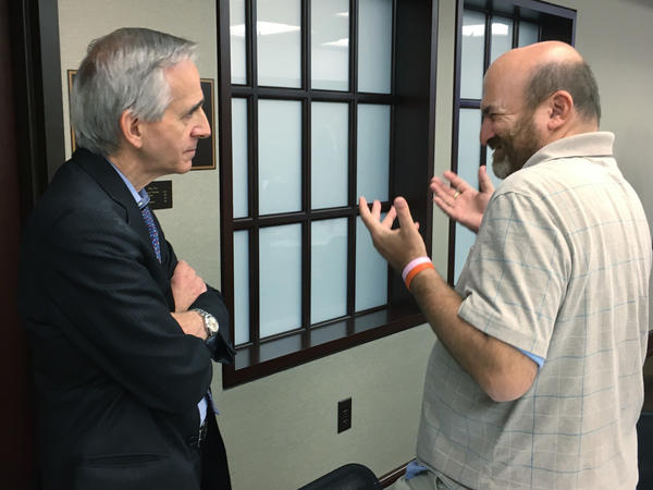 James Meadours, right, speaks with prosecutor Robert Laurino at a summit in New Jersey. In 1993, Laurino won a groundbreaking sexual assault case where the victim had an intellectual disability.