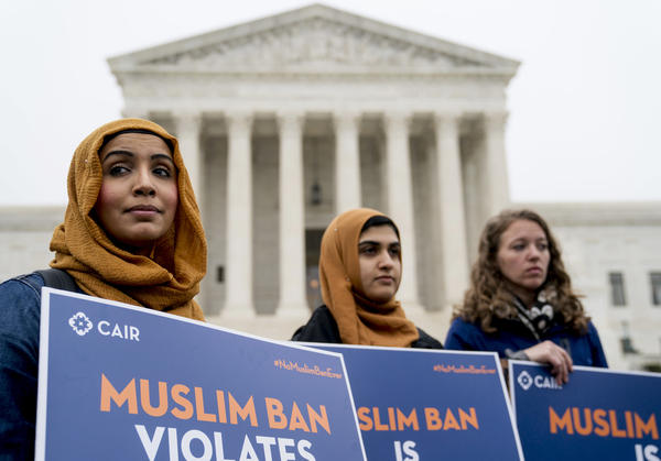 Zainab Chaudry (from left), Zainab Arain and Megan Fair with the Council on American-Islamic Relations stand outside the Supreme Court for a rally against the Trump travel ban before oral arguments.