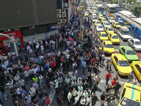 Demonstrators filled the streets of Tehran on Monday to protest economic downtown in Iran.