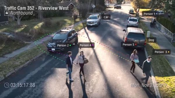 An image from a presentaton by Amazon's Ranju Das shows a demonstration of real-time facial recognition and tracking. Das said the video came from a traffic cam in Orlando, Fla., where police were in a pilot program of Amazon's Rekognition service.