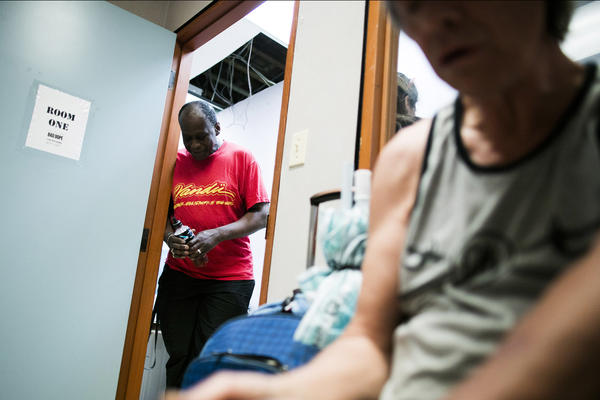 Hugh Lampkin, left, watches over the supervised injection room inside VANDU in Vancouver's Downtown Eastside, British Columbia.