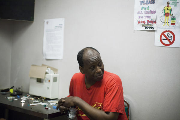 Hugh Lampkin speaks with users inside a supervised injection room in Vancouver, British Columbia. Run by Vancouver Area Network of Drug Users (VANDU), it's a place where peers help each use drugs safely.