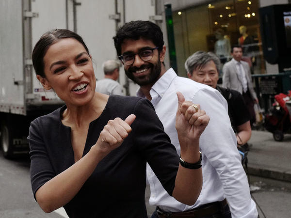 Alexandria Ocasio-Cortez greets a passerby in New York on Wednesday. Many top Democrats said they were surprised and shaken by Ocasio-Cortez's defeat of Rep. Joe Crowley, one of their top leaders.