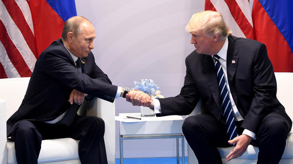 President Trump and Russian President Vladimir Putin shake hands during a meeting on the sidelines of the G20 Summit in Hamburg, Germany, on July 7, 2017. The two leaders are expected to meet again over the summer.