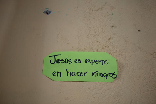 "A sign reading ""Jesus is an expert in making miracles"" hangs a wall of the Eben-ezer church in a gang-controlled neighborhood in San Salvador."