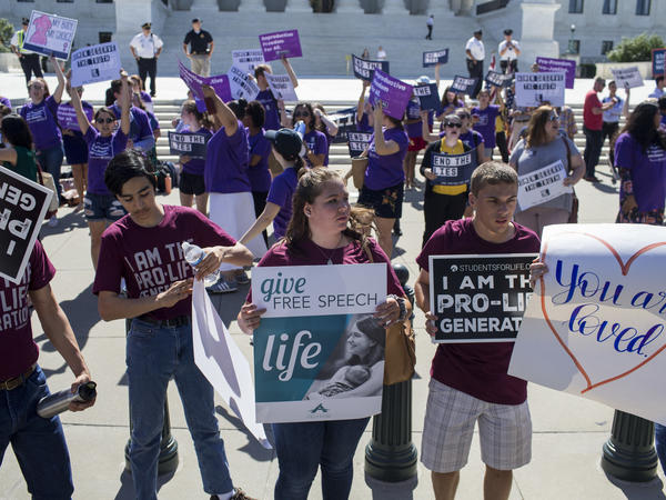 Abortion-rights supporters and foes rally at the Supreme Court on Monday. Almost as soon as Justice Anthony Kennedy's retirement was announced, several anti-abortion-rights groups began their campaigns to influence the pick for his successor.