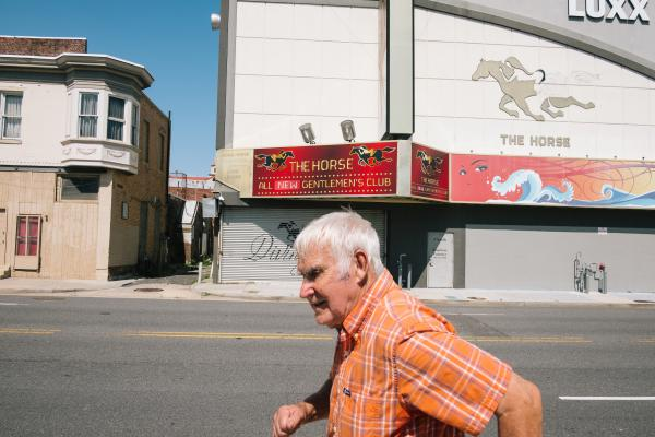 A man walks by The Horse Gentlemen's Club on the south end of the Atlantic City boardwalk.