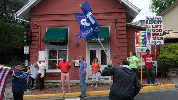 Protesters in front of The Red Hen in Lexington, Va. on Tuesday, June 26. White House press secretary Sarah Sanders was asked to leave the Red Hen restaurant by its owner.