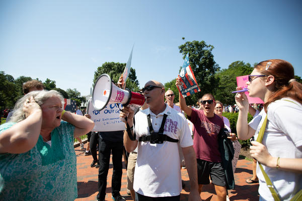 """Anti-abortion-rights activists showed up at the """"Families Belong Together"""" protest and denounced Planned Parenthood at Saturday's event."""
