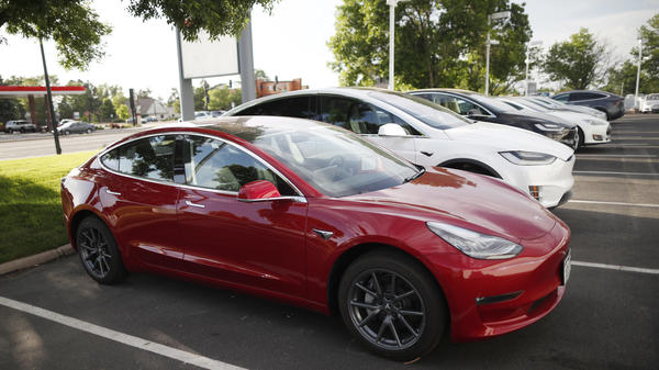 In a photograph from May, a 2018 Tesla Model 3 sits at a dealership in Littleton, Colo.