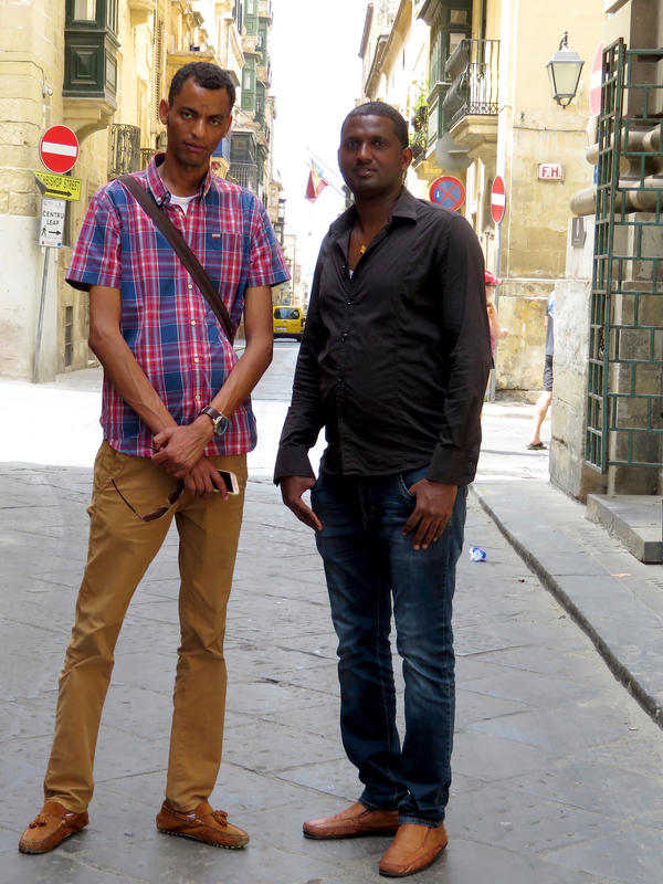 Major Sium (left) and Muzelo Gebregziabher fled Eritrea in 2012. They were rescued at sea while crossing the Mediterranean and now have protection in Malta. Italy and Malta have both recently closed their ports to humanitarian ships carrying rescued migrants.