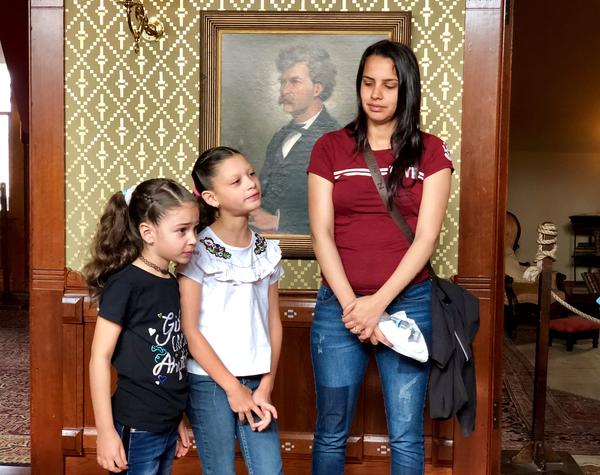 Evacuees from Puerto Rico take a private tour of the historic Mark Twain House in Hartford.