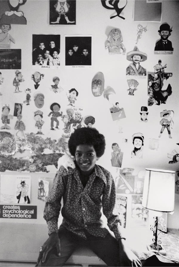 Michael Jackson sits in his room in his family's Encino, Calif., house in 1971. One of his two rats is perched on his shoulder.